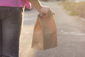 A new report finds that adults and teachers alike are concerned about how children aren't eating before they get to school. How can parents help their kids? Budget their food better. (©istockphoto.com/wyoosumran )