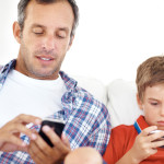 You've heard that kids these days need to put down the phone, but what can be said of parents' tech habits? (©istockphoto.com/GlobalStock)