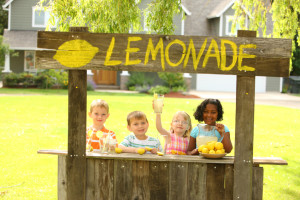 Building a lemonade stand is a great way to teach your young children about money, business and advertising. Have them assist you in buying the cups, signs, lemons, ice, markers, lemonade mix or any other supplies needed for their stand. (©istockphoto.com/viafilms)