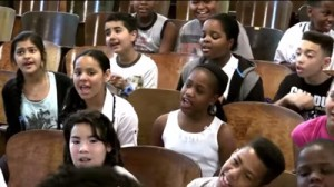 "In a video that has now gone viral, the PS22 chorus performed a rendition of Martina McBride's ""I'm Gonna Love You Through It"" for Adriana Lopez, a teacher at the school who was recently diagnosed with breast cancer, according to Mashable. (Courtesy: YouTube)"