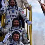 Kazakhstan's cosmonaut Aydyn Aimbetov (C), Russian cosmonaut Sergei Volkov and Denmark's astronaut Andreas Mogensen from the European Space Agency (top) wave as they board the Soyuz TMA-18M spacecraft at the Russian-leased Baikonur cosmodrome early on September 2, 2015. The international crew of Kazakhstan's cosmonaut Aydyn Aimbetov, Russian cosmonaut Sergei Volkov and Denmark's astronaut Andreas Mogensen from the European Space Agency are scheduled to blast off to the International Space Station (ISS) on September 2, 2015.  AFP PHOTO / POOL / KIRILL KUDRYAVTSEV        (Photo credit should read KIRILL KUDRYAVTSEV/AFP/Getty Images)