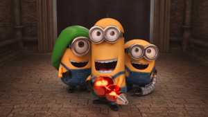 "Stuart, Kevin and Bob dig their new gadgets in ""Minions."" (Universal Pictures)"