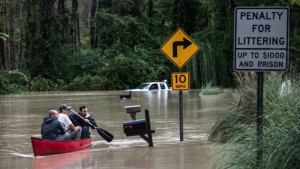 COLUMBIA, SC - OCTOBER 5:   Will Brennan, Matt Talley and Tyler Bahnmuller take a canoe to investigate their homes following flooding in the area October 5, 2015 in Columbia, South Carolina. The state of South Carolina experienced record rainfall amounts over the weekend which stranded motorists and residents and forced hundreds of evacuations and rescues.  (Photo by Sean Rayford/Getty Images)