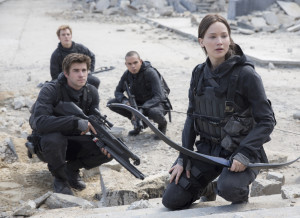 "Gale Hawthorne (Liam Hemsworth, front left), Finnick Odair (Sam Claflin, back left), Messalla (Evan Ross, back right) and Katniss Everdeen (Jennifer Lawrence, front right) in ""The Hunger Games: Mockingjay — Part 2."" (Murray Close, Lionsgate)"