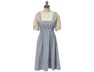 "The iconic blue gingham apron and shirt costume that Judy Garland wore as Dorothy in the 1939 classic ""The Wizard of Oz"" sold for $1,565,000 at a New York auction."