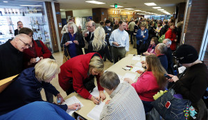 Voters check in before the Utah Republican Caucus at Brighton High School in Salt Lake City, Tuesday, March 22, 2016. (Ravell Call, Deseret News)