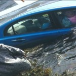 160401211729-woman-rescued-sinking-car-pkg-00002807-exlarge-tease