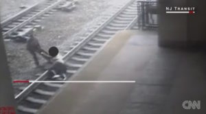 Officer Victor Ortiz is now being hailed as a hero for saving a suicidal man who refused to budge in the face of an oncoming train in New Jersey.