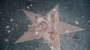A man removed the gold emblem from the middle of Donald Trump's Hollywood star. Officials said work to repair the star would happen immediately.