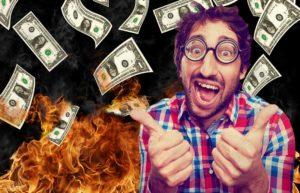 burning-bills-fire-money-thumbs-up-shutterstock
