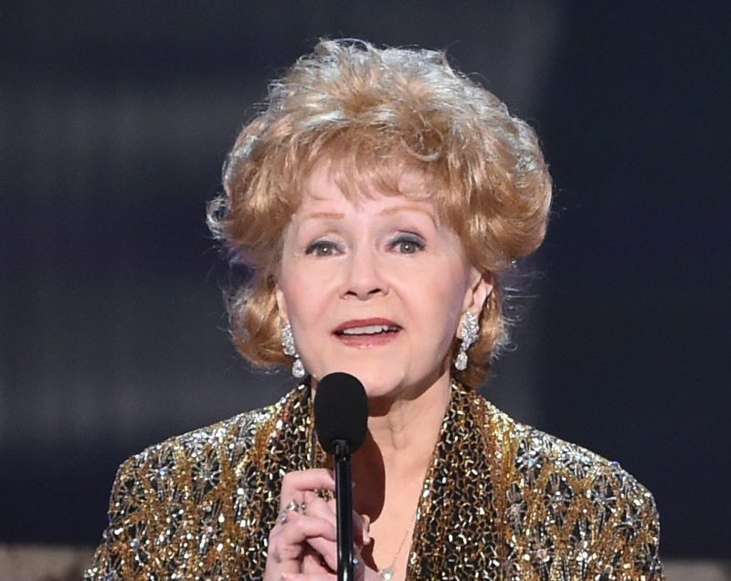 Debbie Reynolds, one of Hollywood's biggest stars in a 1950s and 1960s, was taken to a Los Angeles sanatorium on Wednesday, one day after her daughter Carrie Fisher died, a Los Angeles Times reported.